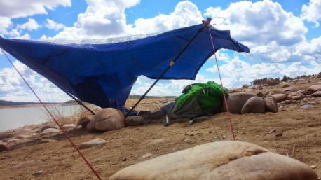 Title : Kite Camp Perquisite Material : tarp, hiking poles, paracord, rocks from site Scale: 6'W x 4'H Site: El Vado Lake NM About: This performance is about personal displacement and creating shelter from the natural force of a breeze. I was feeling exposed and removed from my natural elements; Wi-Fi, A.C and my T.V. All I wanted to do was take a nap to feel calm as my given perquisite. Vimeo: https://vimeo.com/123806066
